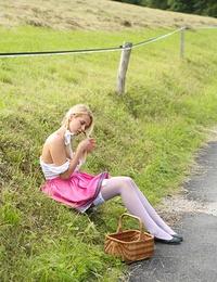 Pigtailed blonde teen honey Tirol masturbating outdoors